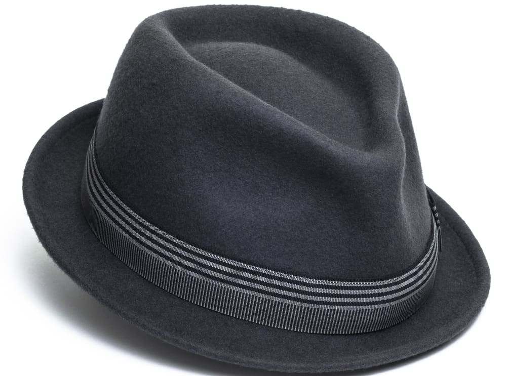 This is a close look at a dark gray trilby hat with a striped band.