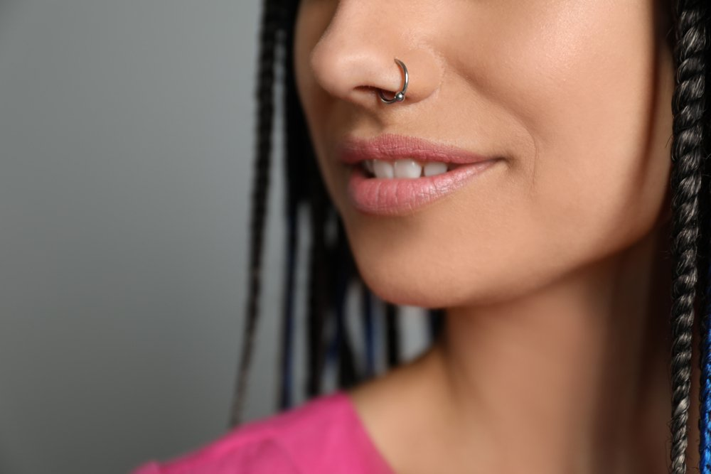 Close up of a nose ring on a smiling face