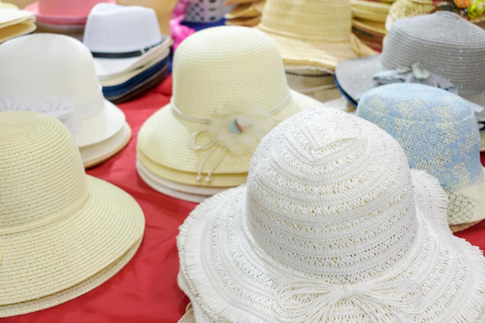These are stacks of bonnet hats on display for sale.