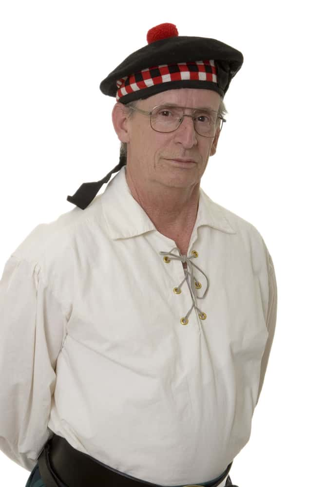 This is a man wearing a traditional Scottish sailor costume topped with a Glengarry bonnet.