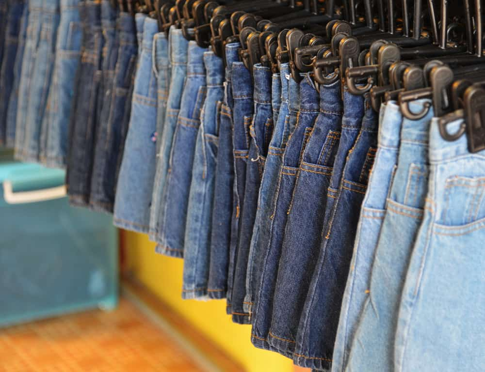 This is a row of various denim skirts on display at a shop.