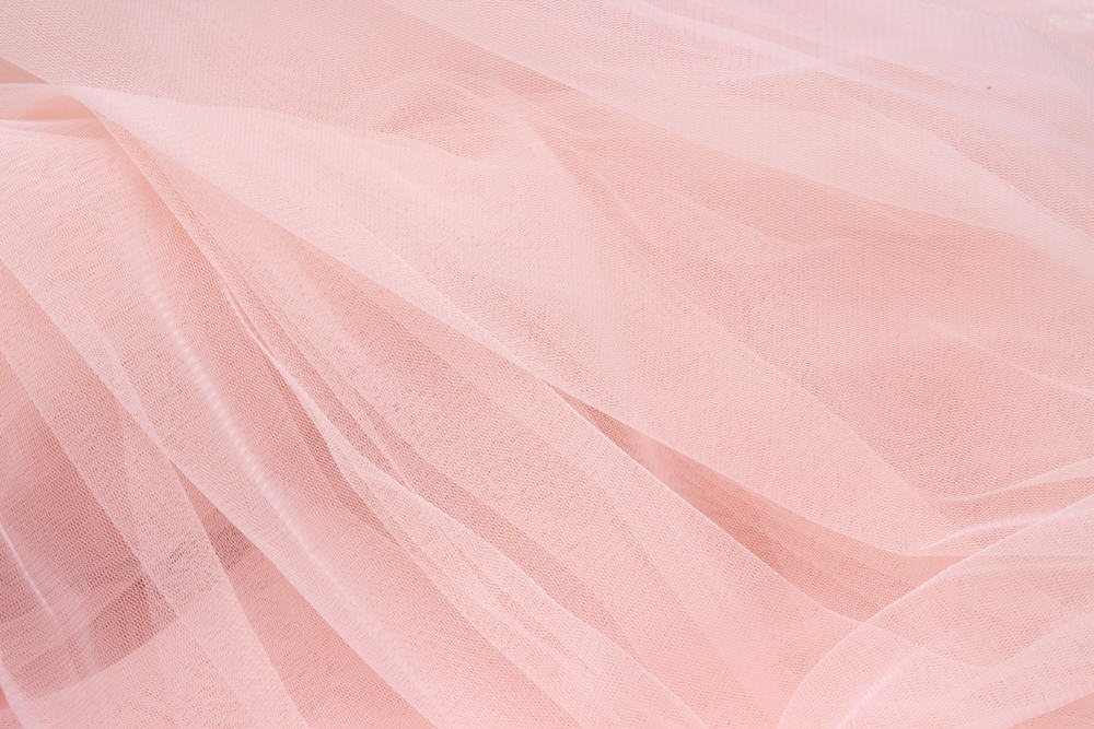This is a close look at a pink delicate sheer fabric.