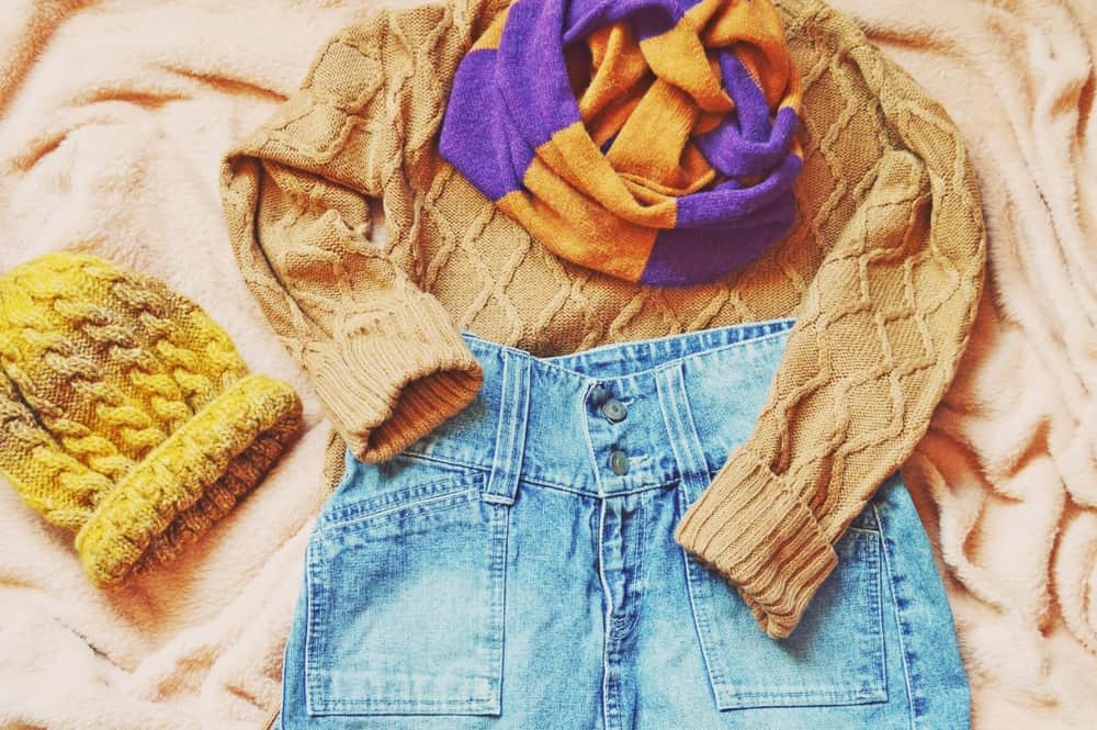 This is a prepared outfit of the day with a denim skirt and a brown sweater.