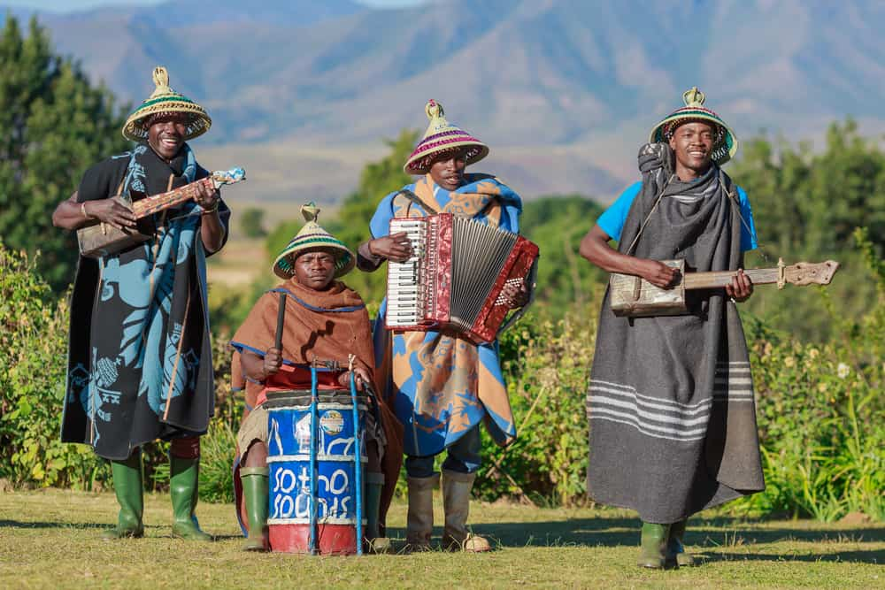 These are local African musicians wearing colorful knit conical hats.