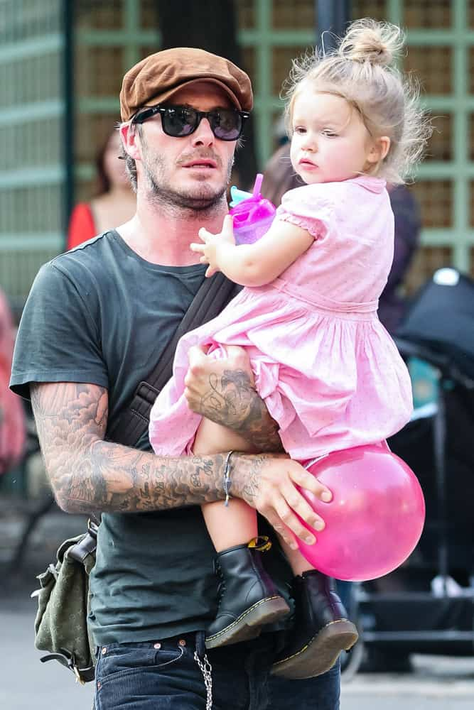 David Beckham was walking the streets of New York back in 2013 with his daughter while wearing an ivy cap.
