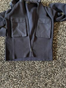 Two front chest pockets on the Elgin Knit Hoody by Canada Goose