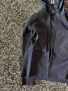 Pocket zipper on the Elgin Knit Hoody by Canada Goose
