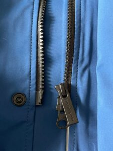 Close up view of zipper for Canada Goose rain jacket