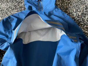Rear vent flap on Canada Goose rain jacket