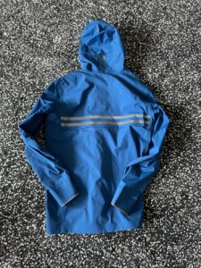 Rear view of Canada Goose rain jacket including reflectors on back, hood and cuffs
