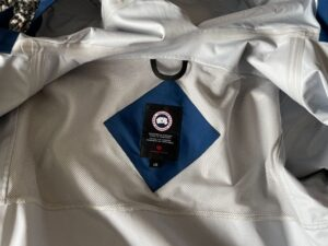 Inside venting and tag of Canada Goose rain jacket