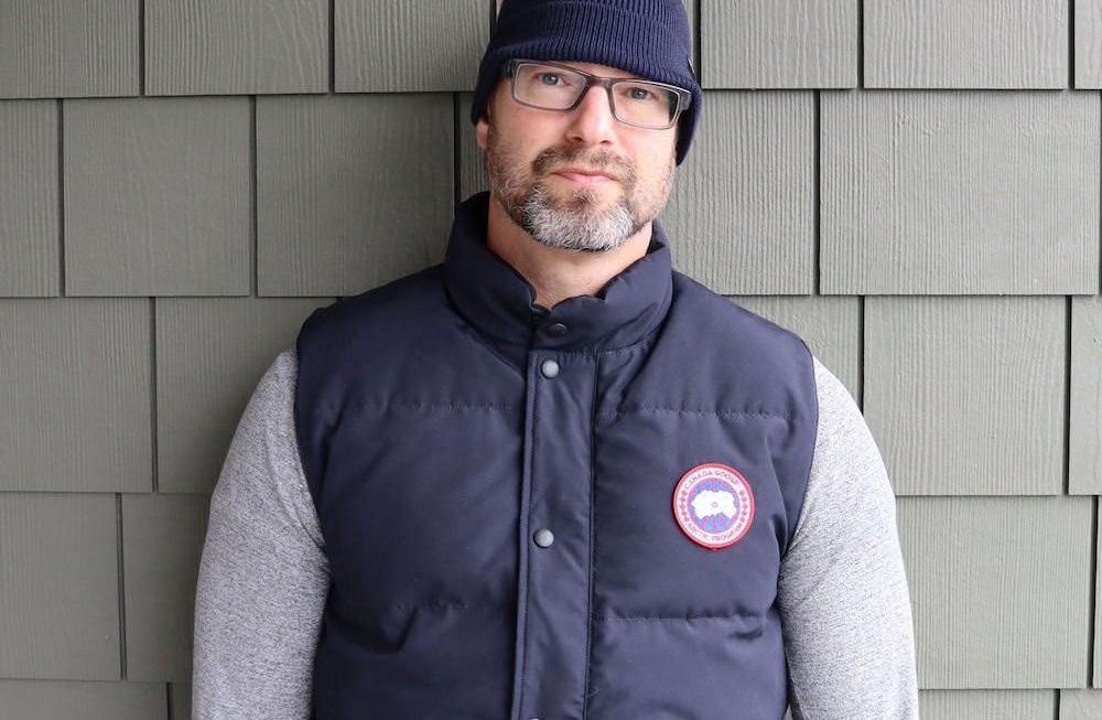 Wearing navy blue Canada Goose Vest