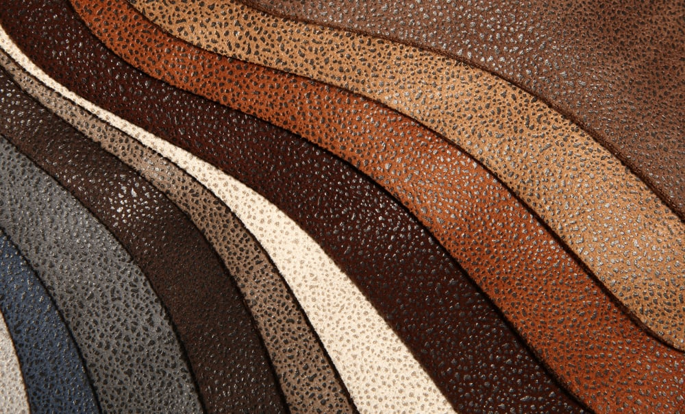 Strips of faux leather in various colors and tones.