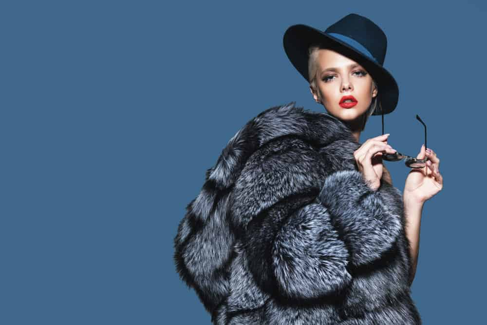 This is a fashionable woman wearing a dark fur coat.