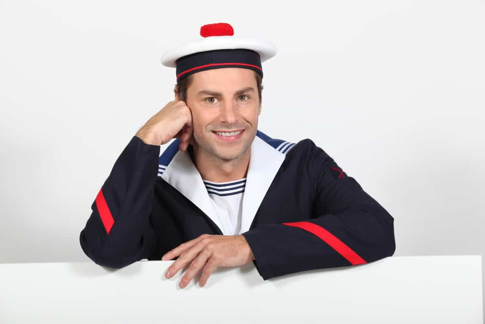 A man wearing a French sailor uniform.