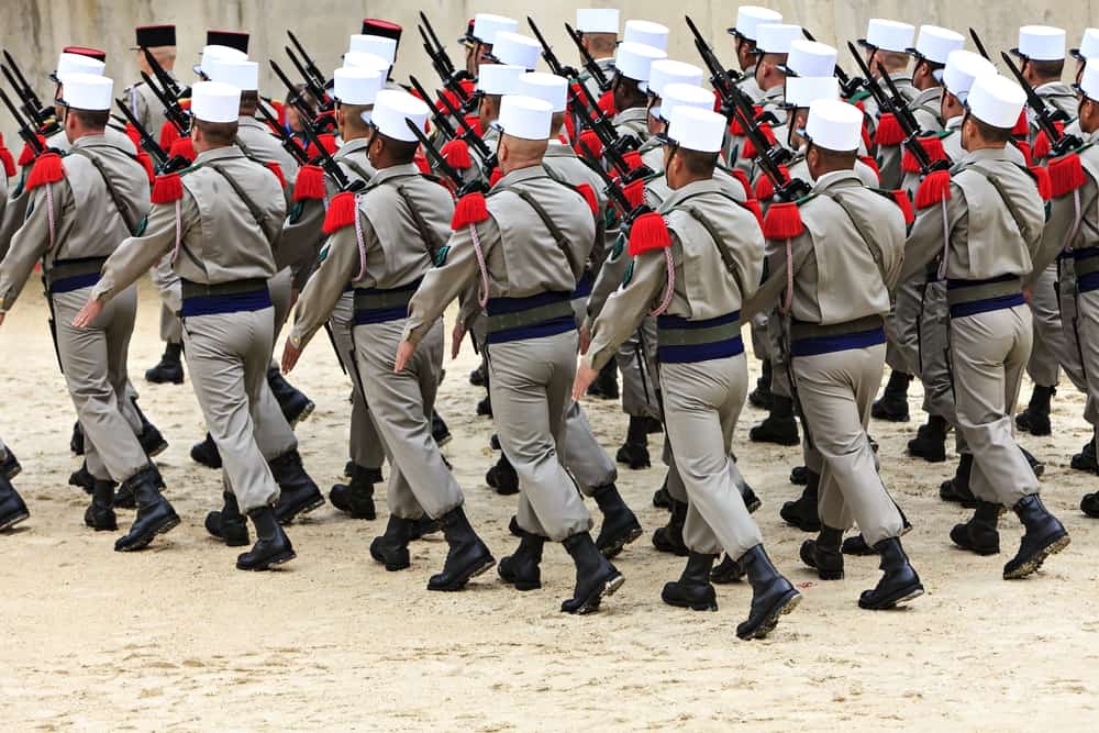 This is a parade of soldiers in formation carrying weapons.