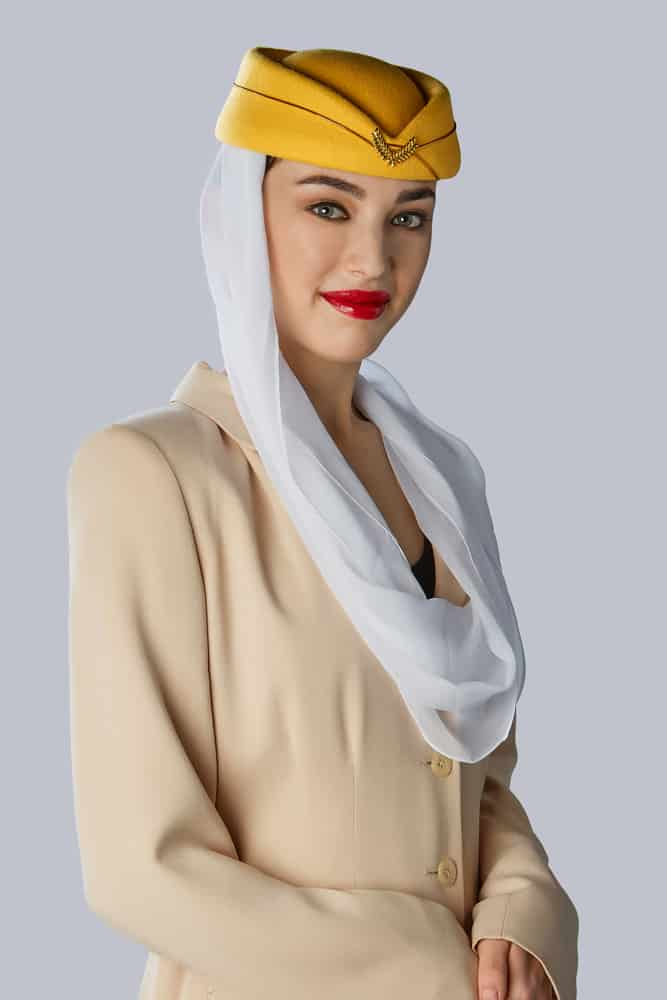 This is a woman wearing a classic stewardess uniform with a pillbox hat.