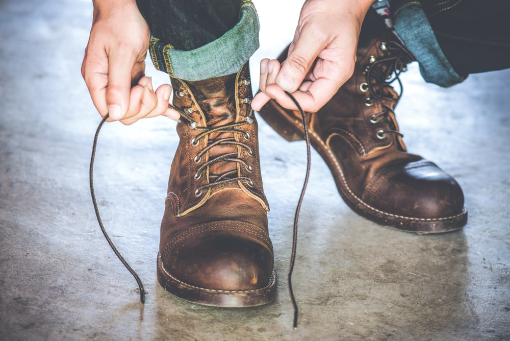 Close up of a person tying boots
