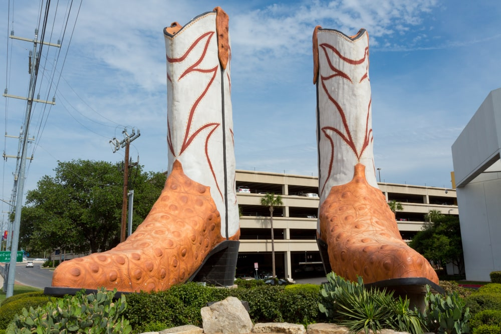 Enormous pair of boots in front of a building