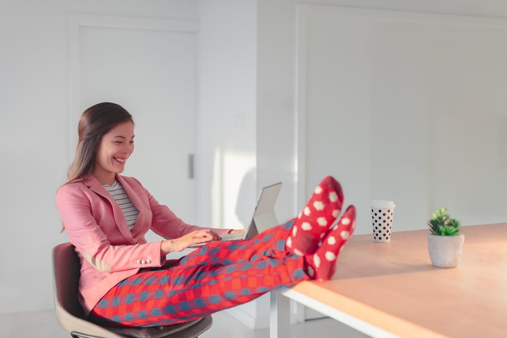 Person sitting at a desk with feet up wearing sweatpants