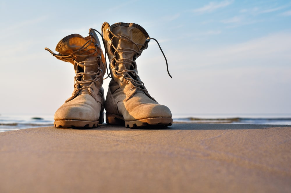 Pair of boots standing on a beach alone