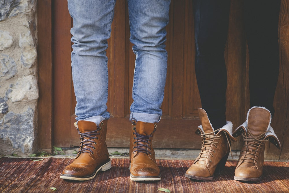Man and woman's feet wearing boots